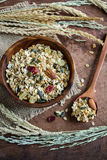 Oat and whole wheat grains flake in wooden bowl Stock Photos