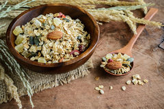 Oat and whole wheat grains flake in wooden bowl Royalty Free Stock Photos