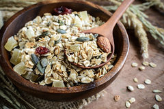 Oat and whole wheat grains flake in wooden bowl Stock Images