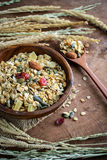 Oat and whole wheat grains flake in wooden bowl Royalty Free Stock Images