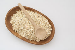 Oat and wooden spoon Royalty Free Stock Photos