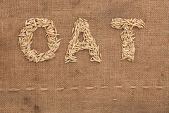 Oat word written on sackcloth Royalty Free Stock Photography