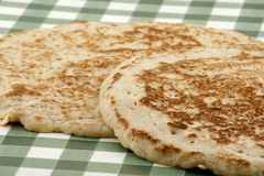 Oatcakes. Traditional derbyshire oatcakes on a gingham cloth Stock Photos