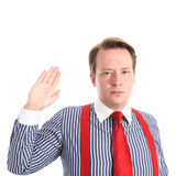 Oath (serious). Young serious businessman testifiing under oath - isolated on white background and retouched Stock Photo
