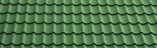 Сoating metal tile. Metal green matte color, flooring for home, horizontal banner Royalty Free Stock Photography