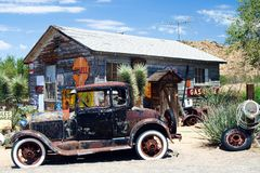 OATMAN ARIZONA, USA - AUGUST 7. 2009: American vintage car in front of abandoned wooden historic old gas station royalty free stock image