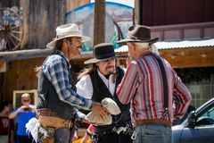 The City of Oatman on Route 66 in Arizona. Three cowboys preparing for the show. Oatman is a town in the Black Mountains of Mohave County, Arizona, United stock photo