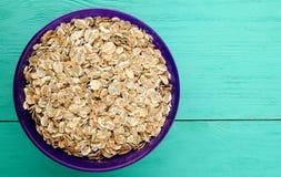 Oatmeal σε έναν ξύλινο πίνακα Oatmeal τοπ άποψη Στοκ φωτογραφία με δικαίωμα ελεύθερης χρήσης