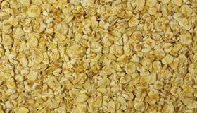 Oatmeal. Macro photo of cereals abstract background Stock Photos