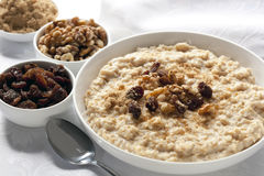 Oatmeal. Bowl of oatmeal with raisins, walnuts, and brown sugar Stock Photography