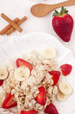 Oatmeal. Porridge with milk, strawberry, banana and cinnamon Stock Photography