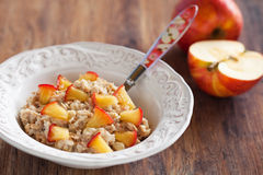 Oatmeal. Cereal with caramelized apples, selective focus Royalty Free Stock Photo