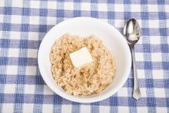 Καυτό Oatmeal με το βούτυρο Στοκ Εικόνες