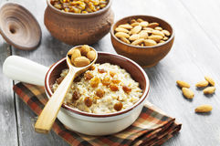 Oatmeal with almonds and raisins Royalty Free Stock Image