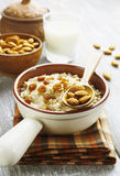 Oatmeal with almonds and raisins Stock Photos