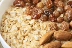 Oatmeal with almonds and raisins. Useful breakfast. Tasty oatmeal with almonds and raisins. Useful breakfast. Healthy food Stock Image