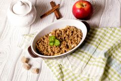 Oatmeal apple cowberry crumble cobbler in ceramic bowl. Close up, top view, horizontal stock photo