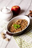 Oatmeal apple cowberry crumble cobbler in ceramic bowl Stock Photography