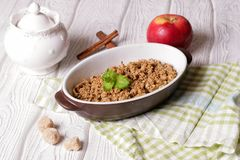 Oatmeal apple cowberry crumble cobbler in ceramic bowl. Close up, top view, horizontal royalty free stock photography