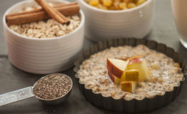 Oatmeal with apple, honey and cinnamon Royalty Free Stock Images