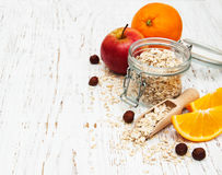Oatmeal with apple and oranges Stock Images