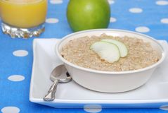 Oatmeal with apple slices Stock Image