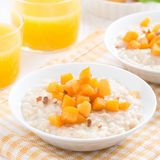 Oatmeal with apricots and walnuts for breakfast Royalty Free Stock Image
