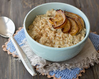 Oatmeal with baked apples and cinnamon Royalty Free Stock Photo