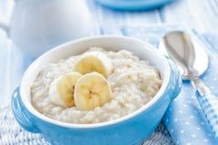 Oatmeal with banana stock photo