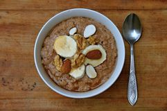Oatmeal. With banana, chocolate, almonds, walnuts, honey Stock Images