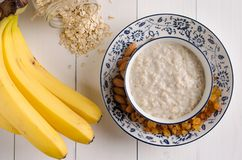 Oatmeal with banana, raisins, almonds and milk Royalty Free Stock Images