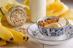 Oatmeal with banana, raisins, almonds and milk Royalty Free Stock Photo