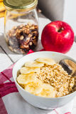 Oatmeal with bananas, apples, nuts and dried fruit jar Stock Images