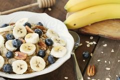 Oatmeal Bananas, Blueberries, honey and pecans stock images