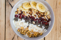 Oatmeal with bananas, cranberry, chia seeds, coconut shreds, alm Royalty Free Stock Image