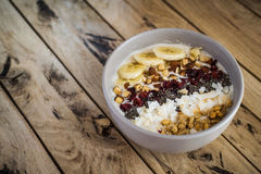 Oatmeal with bananas, cranberry, chia seeds, coconut shreds, alm Stock Images