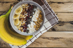 Oatmeal with bananas, cranberry, chia seeds, coconut shreds, alm Royalty Free Stock Photo
