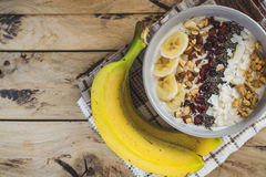 Oatmeal with bananas, cranberry, chia seeds, coconut shreds, alm Royalty Free Stock Photos