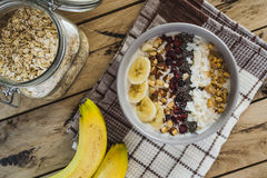 Oatmeal with bananas, cranberry, chia seeds, coconut shreds, alm Stock Photos