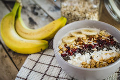Oatmeal with bananas, cranberry, chia seeds, coconut shreds, alm Stock Image