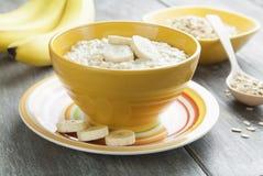 Oatmeal with bananas Stock Photography
