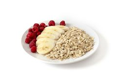 Breakfast of oatmeal with berries and bananas. Oatmeal with berries and bananas stock photos
