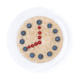 Oatmeal with berries in the form of dial, isolated Royalty Free Stock Images