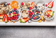 Oatmeal with berries and nuts in glass jars, top view. Healthy breakfast Royalty Free Stock Photo