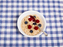 Oatmeal with Berries and Spoon Royalty Free Stock Photography