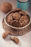 Oatmeal biscuits. Cookies with grains and milk in the wicker basket Stock Images