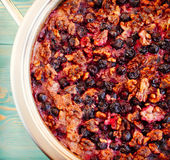 Oatmeal, black currant and walnut casserole, close-up. Oatmeal, black currant and walnut casserole in pan, close-up, toned Royalty Free Stock Image