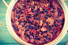 Oatmeal, black currant and walnut casserole. In pan, toned Stock Images