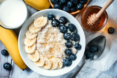 Oatmeal and blackberries Stock Photos