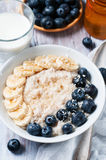 Oatmeal and blackberries Stock Image